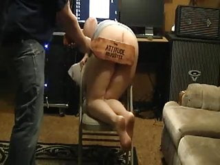 Spanking accompanying bare ass for chastisement with scull