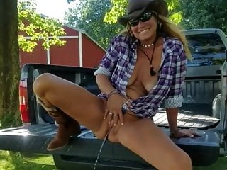 Mom peeing from a pickup truck