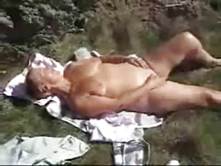 Nasty granny fingering outdoor. Amateur