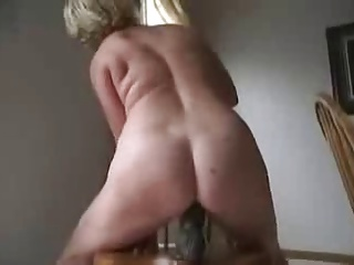 granny dildo fucking on a chair