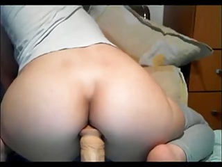 Teen girl sits on the brush toy